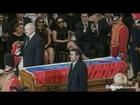 Mahmoud Ahmadinejad kisses Hugo Chavez's coffin